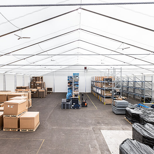 Temporary building with stored goods inside perspective
