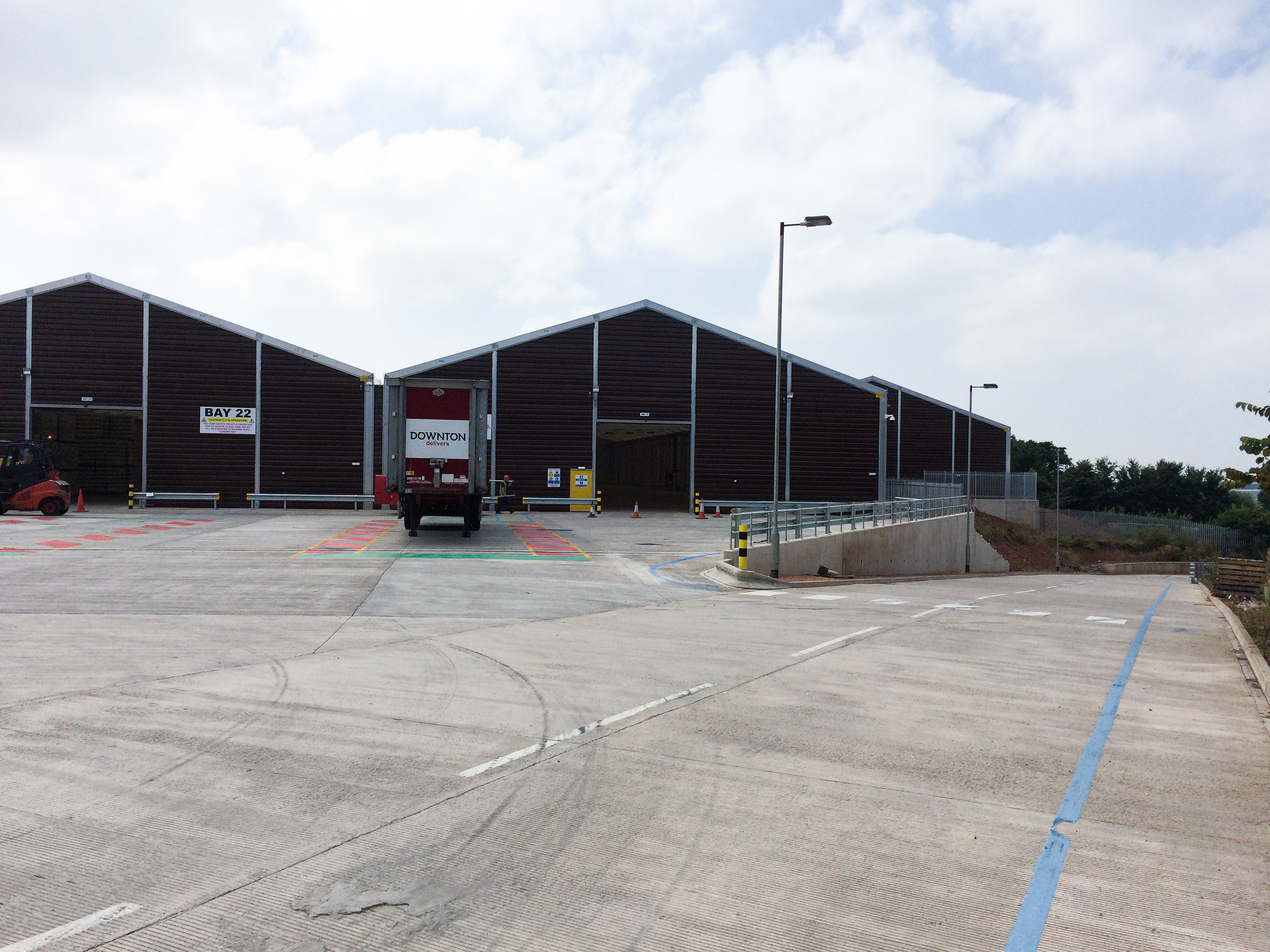 Two temporary warehouses for the rotor blade repair with tarpaulin gates